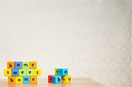 Alphabet blocks spelling home sweet home Stock Photo - Premium Royalty-Free, Code: 614-03903071
