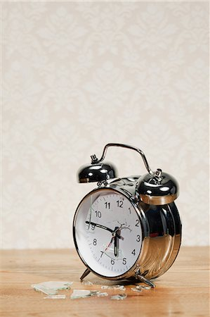Smashed alarm clock Stock Photo - Premium Royalty-Free, Code: 614-03903105