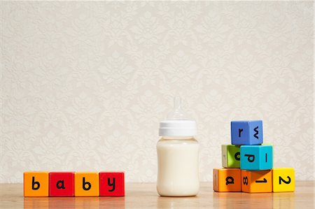 Baby milk and alphabet blocks Stock Photo - Premium Royalty-Free, Code: 614-03903124