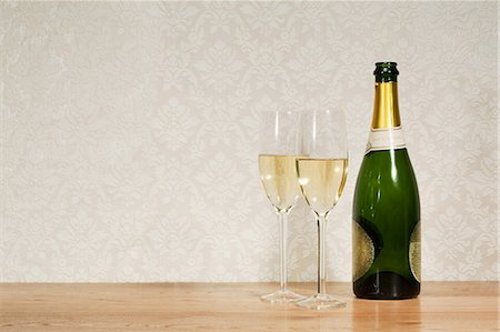 Champagne bottle and two glasses Stock Photo - Premium Royalty-Free, Code: 614-03903141