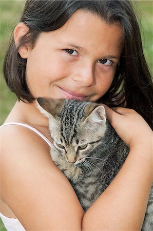 preteen girl pussy - Girl holding pet cat, portrait Stock Photo - Premium Royalty-Free, Code: 614-03903189