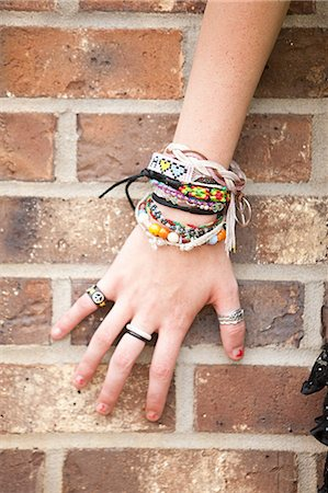ring hand woman - Woman's hand with bracelets by brick wall Stock Photo - Premium Royalty-Free, Code: 614-03981254