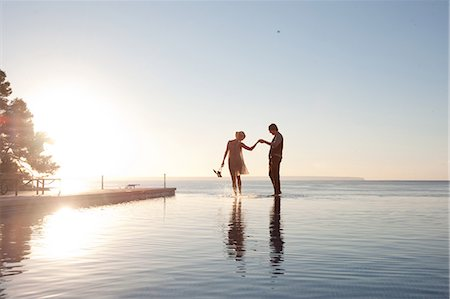 silhouettes - Couple in the ocean at sunset Stock Photo - Premium Royalty-Free, Code: 614-03981473