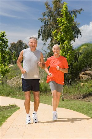 Mature couple jogging together Stock Photo - Premium Royalty-Free, Code: 614-03981975