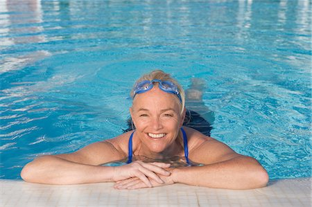 Mature woman in swimming pool Stock Photo - Premium Royalty-Free, Code: 614-03981986
