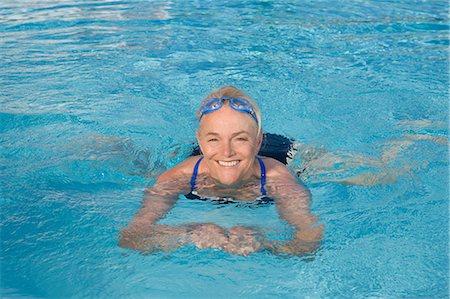 Mature woman swimming in pool Stock Photo - Premium Royalty-Free, Code: 614-03981990