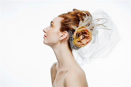 Woman with flower hair accessory Stock Photo - Premium Royalty-Free, Code: 614-03982049