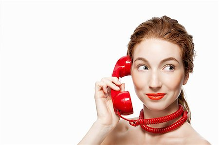 phone cord - Woman with red telephone cord wrapped around neck Stock Photo - Premium Royalty-Free, Code: 614-03982062