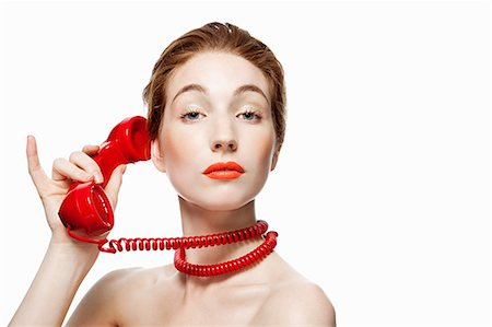 Woman with red telephone cord wrapped around neck Stock Photo - Premium Royalty-Free, Code: 614-03982063