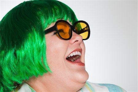 Woman with green wig and sunglasses laughing Stock Photo - Premium Royalty-Free, Code: 618-04251550