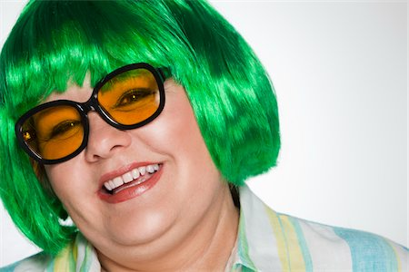 Overweight woman with green wig and sunglasses Stock Photo - Premium Royalty-Free, Code: 618-04251551