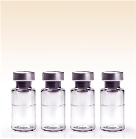 repeating - Glass vials in a row Stock Photo - Premium Royalty-Free, Code: 618-04251682