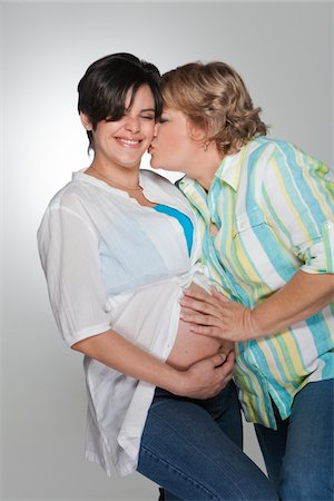 pregnant women kissing - Mother  touching pregnant daughter's belly Stock Photo - Premium Royalty-Free, Code: 618-04251701