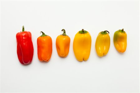 spicy - Sweet chilli peppers in a row Stock Photo - Premium Royalty-Free, Code: 618-05605450