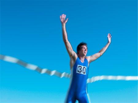 finish line - Man crossing finish line Stock Photo - Premium Royalty-Free, Code: 618-05761584