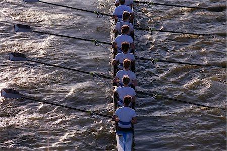 sport rowing teamwork - Rear view of people sitting in canoe Stock Photo - Premium Royalty-Free, Code: 618-05761587