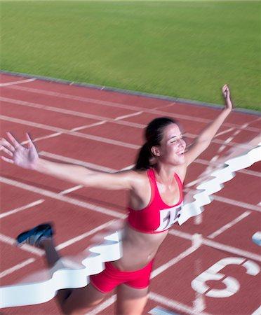 finish line - Smiling woman crossing finish line Stock Photo - Premium Royalty-Free, Code: 618-05761592