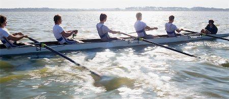 sport rowing teamwork - View of people oaring canoe Stock Photo - Premium Royalty-Free, Code: 618-05761604