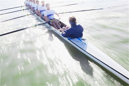 sport rowing teamwork - Men sitting in a line oaring canoe Stock Photo - Premium Royalty-Free, Code: 618-05761608