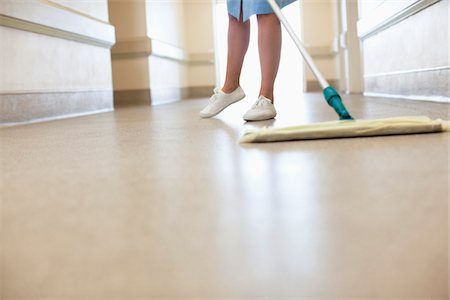 floor - Low section of woman cleaning floor Stock Photo - Premium Royalty-Free, Code: 618-05761629