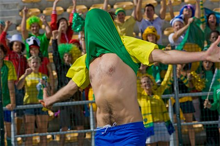 soccer fan - Brazilian soccer player celebrating win with shirt over his head at game in Cape Town, South Africa Stock Photo - Premium Royalty-Free, Code: 618-05800187