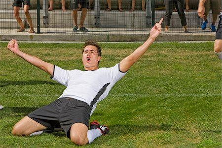 scoring - German soccer player raising hands after goal at game in Cape Town, South Africa Stock Photo - Premium Royalty-Free, Code: 618-05800182