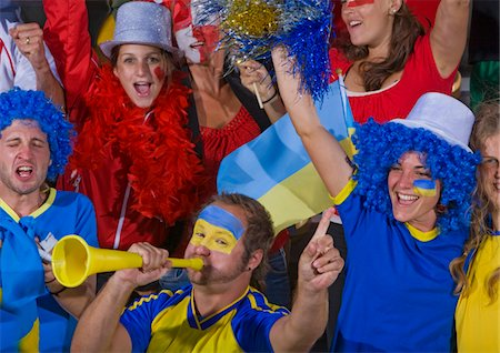 soccer fan - Ukrainian fans at soccer game in Cape Town, South Africa Stock Photo - Premium Royalty-Free, Code: 618-05800190