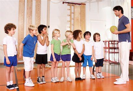 Young schoolchildren and gym teacher at school Stock Photo - Premium Royalty-Free, Code: 618-05800356