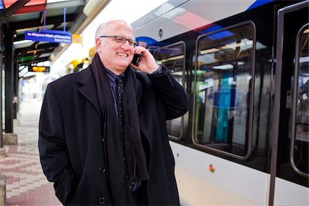 A middle aged businessman using a cell phone. Stock Photo - Premium Royalty-Free, Code: 618-05818129