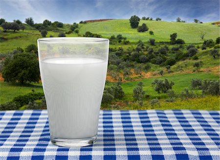 Glass of milk shot outdoors Stock Photo - Premium Royalty-Free, Code: 618-05818220