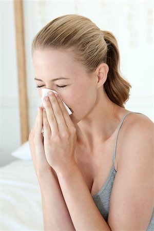 people coughing or sneezing - Woman Sneezing Into Tissue Stock Photo - Premium Royalty-Free, Code: 618-05963149