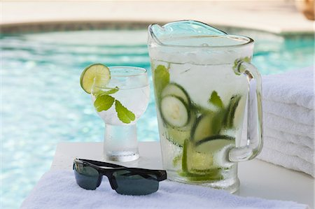 Pitcher and glass of water with cucumber by pool Stock Photo - Premium Royalty-Free, Code: 618-06119074