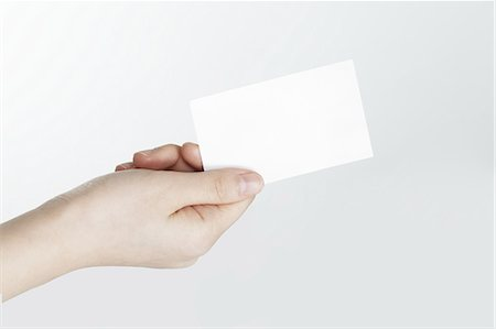 Woman holding business card,hand close-up Stock Photo - Premium Royalty-Free, Code: 618-06119086