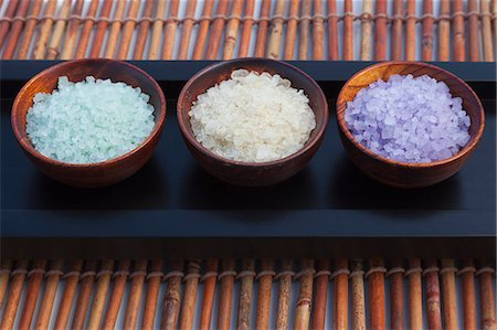Three different bath salts on wooden bowls outdoor Stock Photo - Premium Royalty-Free, Code: 618-06119198