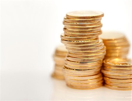 Stacks of gold coins Stock Photo - Premium Royalty-Free, Code: 618-06119295
