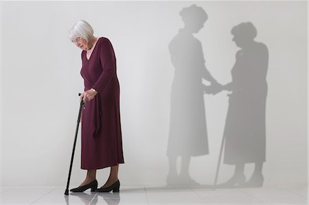 Senior woman misses the support of her carer Stock Photo - Premium Royalty-Free, Code: 618-06318272