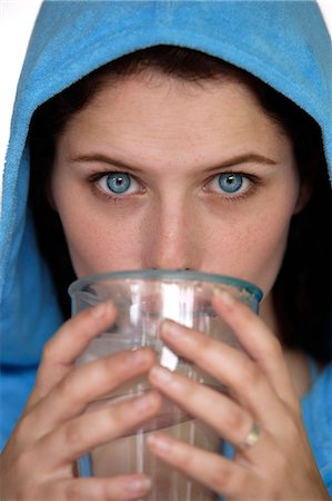 drinking water glass - Woman in blue hooded vest, drinking water Stock Photo - Premium Royalty-Free, Code: 618-06318435