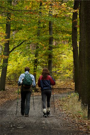 Young couple on walking trail Stock Photo - Premium Royalty-Free, Code: 618-06318631
