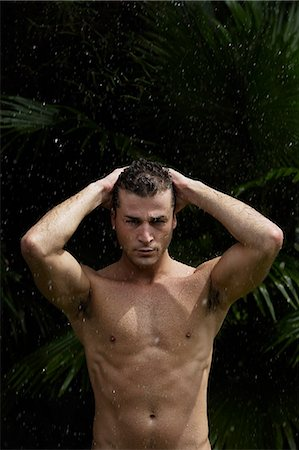 man having outdoor shower Stock Photo - Premium Royalty-Free, Code: 618-06318797