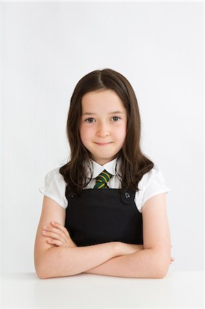 school girl uniforms - Young school girl sitting at desk Stock Photo - Premium Royalty-Free, Code: 618-06405070