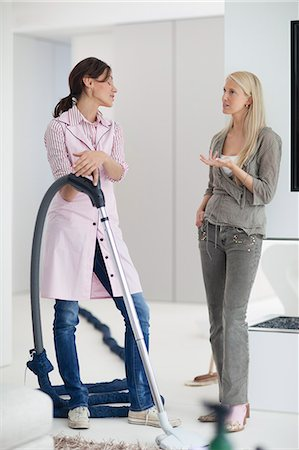 Mature woman talking to cleaner in home Stock Photo - Premium Royalty-Free, Code: 618-06405507