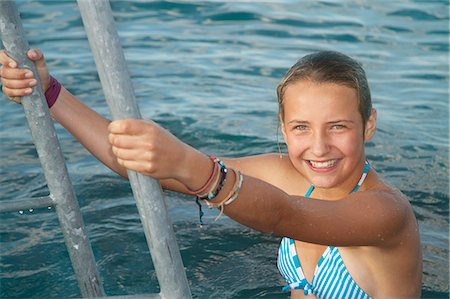 Girl climbing out of sea, portrait Stock Photo - Premium Royalty-Free, Code: 618-06405666