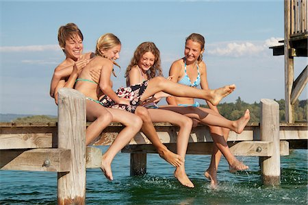 Young friends playing on pier Stock Photo - Premium Royalty-Free, Code: 618-06405668