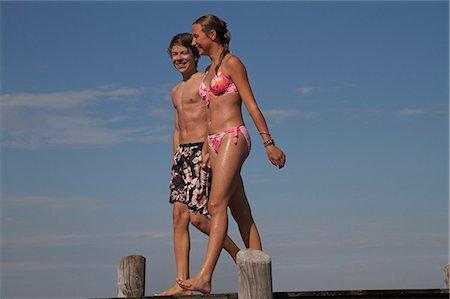 preteen bikini - Young teenage couple walking along pier Stock Photo - Premium Royalty-Free, Code: 618-06405687