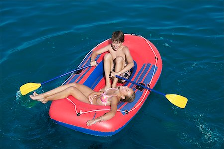 Teenage boy in dinghy on sea, high angle view Stock Photo - Premium Royalty-Free, Code: 618-06405689