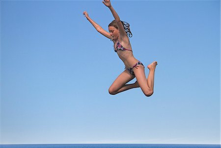 preteen bathing suit - Girl jumping into sea, side view Stock Photo - Premium Royalty-Free, Code: 618-06405696