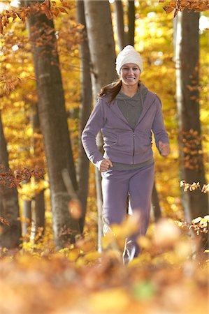 Mature woman jogging in park Stock Photo - Premium Royalty-Free, Code: 618-06405853
