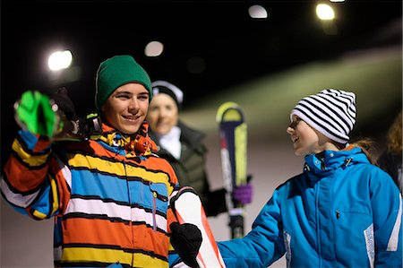 Boys and girls on ski slope at night Stock Photo - Premium Royalty-Free, Code: 618-06405995