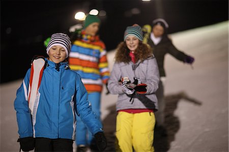 Boys and girls on ski slope at night Stock Photo - Premium Royalty-Free, Code: 618-06405993