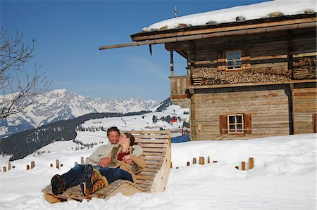 property release - Couple relaxing on wooden chair in ski resort Stock Photo - Premium Royalty-Free, Code: 618-06406020